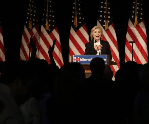 Clinton supports wage increases, profit sharing