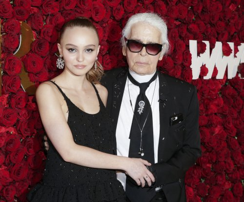 Lily-Rose Depp supports Karl Lagerfeld at WWD Honors