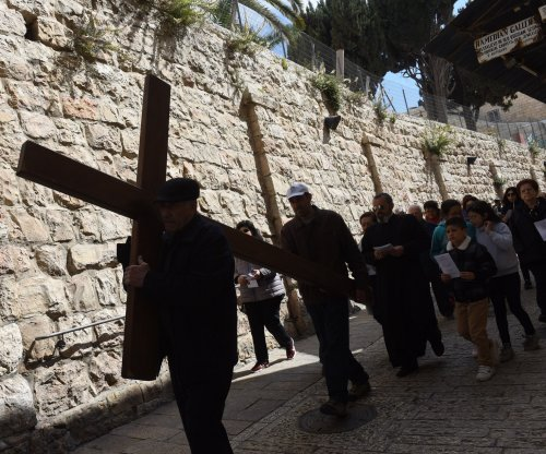 Christians re-enact cross procession worldwide to mark Good Friday