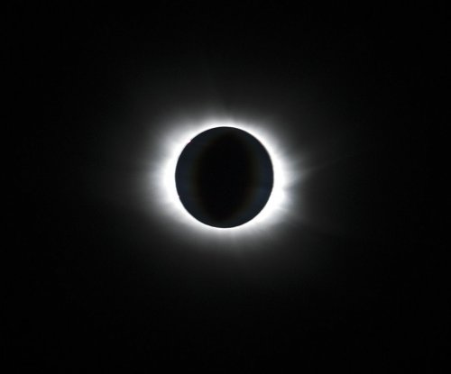 Stunning images of total eclipse from Earth, space