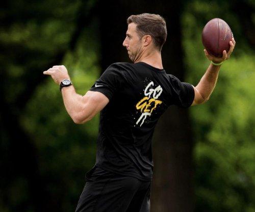 Redskins QB Alex Smith throws football at OTAs