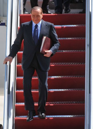 Berlusconi absent from his bribery trial