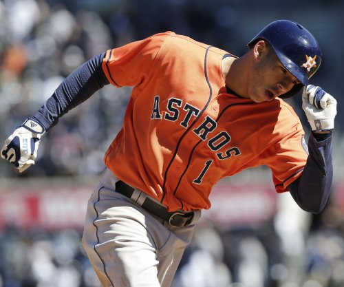 Carlos Correa gets key hit in Houston Astros' win over Atlanta Braves