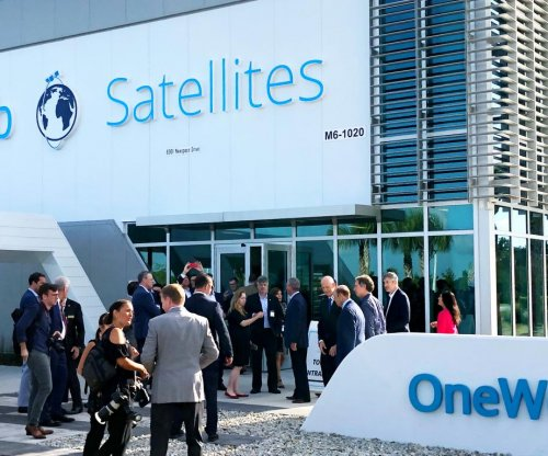 Communications satellite firm OneWeb plans to start monthly launches in December