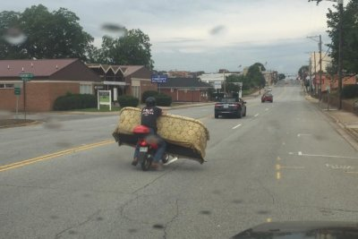 North Carolina man uses small scooter to move huge couch