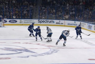 Winnipeg Jets' Jacob Trouba banks puck off glass for crazy goal