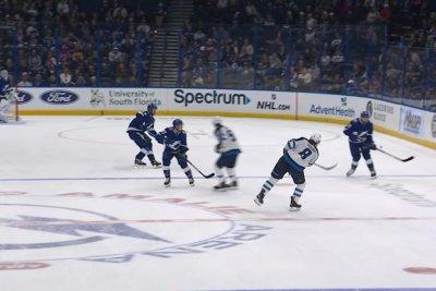Winnipeg Jets' Jacob Trouba banks puck off glass for crazy goal
