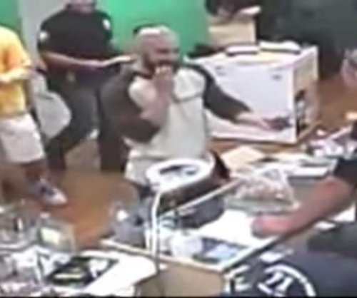 California police in pot shop raid filmed eating edibles, mocking amputee