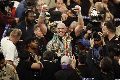 Tyson Fury hands Deontay Wilder first loss with seventh-round TKO