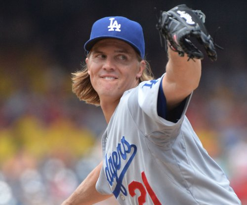 Zack Greinke, Howie Kendrick help Los Angeles Dodgers beat Los Angeles Angels