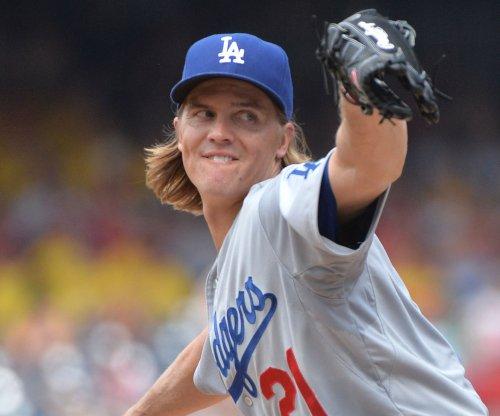 Zack Greinke, Howie Kendrick help Los Angeles Dodgers beat Los Angeles Angels