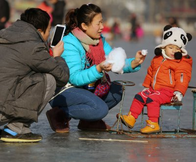More mothers in China giving second child their maiden name