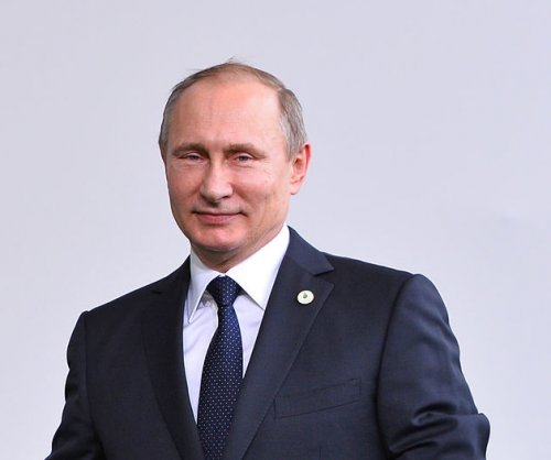 Putin calls Obama 'decent' on Libya admission in lengthy Q&A session