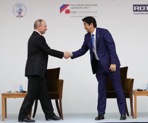 Vladimir Putin, Shinzo Abe agree on joint Russian-Japan activities on Kuril Islands
