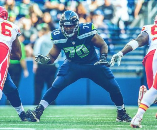 Seattle Seahawks LT Rees Odhiambo holds up end of the line as George Fant replacement