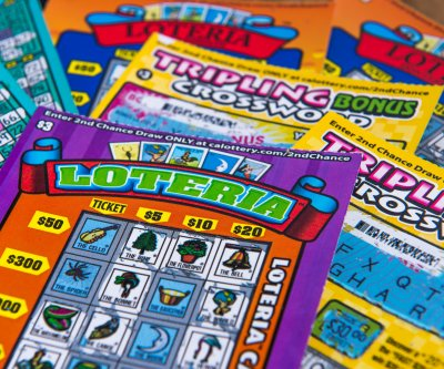 Woman wins lottery jackpot just months after her father