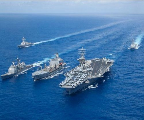 Aircraft carrier strike groups Nimitz, Reagan team up in Philippine Sea