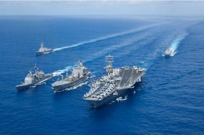 Aircraft carrier strike groups Nimitz, Reagan team up in Philippine Sea