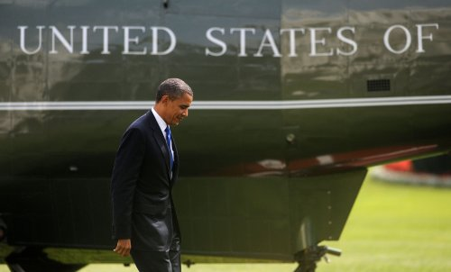 Obama, Romney aides downplay debate hopes