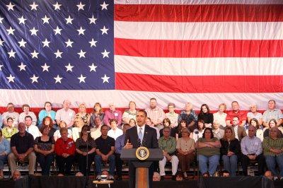 Obama rides high at 100 days, but economy still untamed
