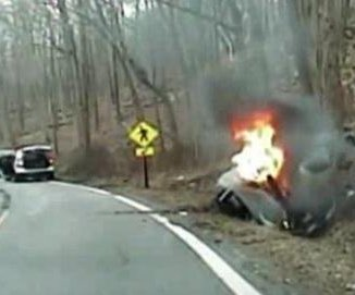 Video: Officers pull woman from burning car that explodes