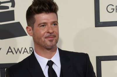 Robin Thicke and girlfriend April Love Geary welcome daughter