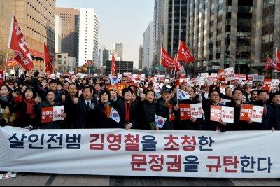 Political clash escalates over North Korean official's visit