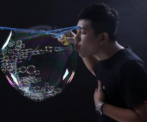 Taiwan man blows 783 bubbles inside of larger bubble for world record