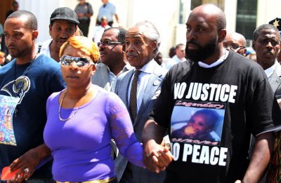 Michael Brown's family pleads for 'day of silence' for funeral