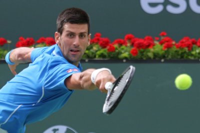 Djokovic, Murray battle their way into Miami QFs