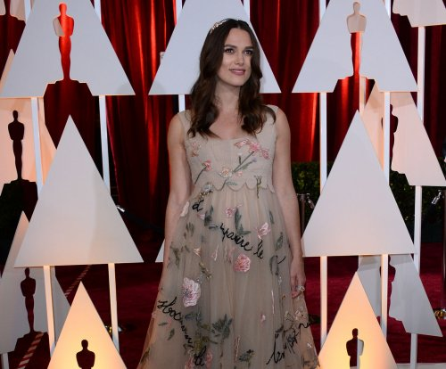 Director apologizes to Keira Knightly for 'petty, mean' comments