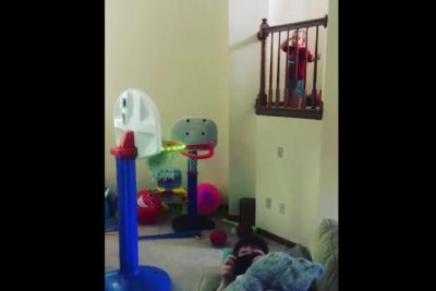 Boy, 2, sinks over-the-railing basketball trick shots