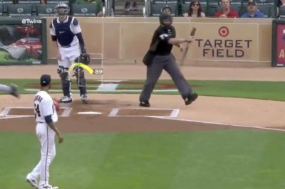 Umpire makes super smooth catch on bat flip from Detroit Tigers' Nick Castellanos