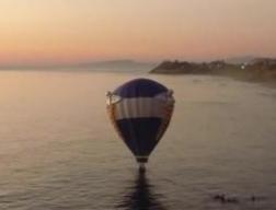 Hot air balloon marriage proposal cut short by ocean rescue