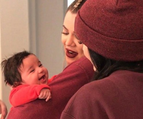 Khloe Kardashian holds Rob's daughter Dream in new photo