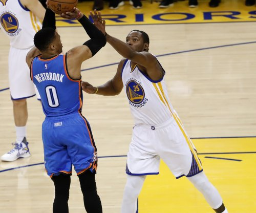 Kevin Durant settling in with Golden State Warriors' team-first approach