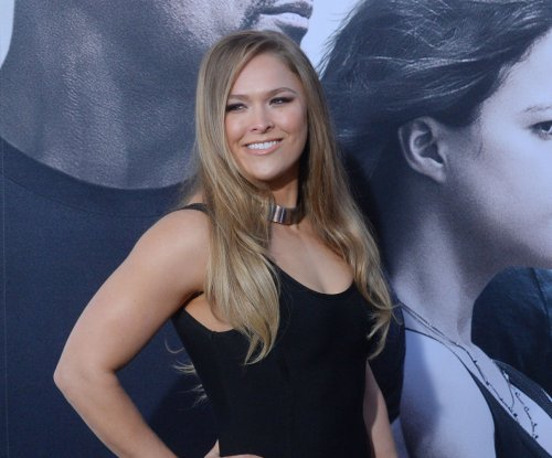 Ronda Rousey's coach: She should be 'OK with herself not as a fighter'