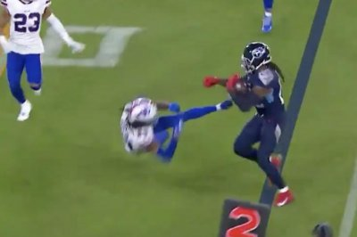 Titans RB Derrick Henry delivers devastating stiff-arm to Bills' Josh Norman