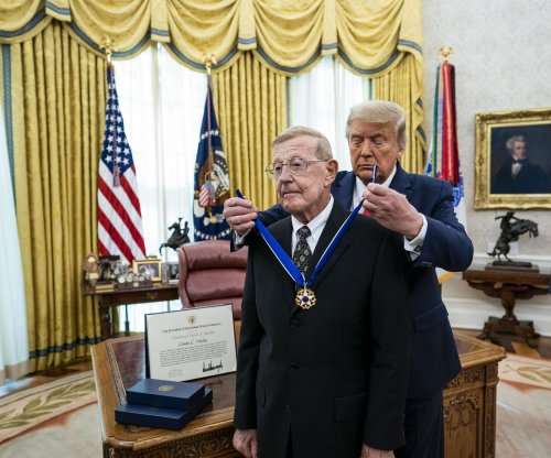 Trump awards Medal of Freedom to former football coach Lou Holtz