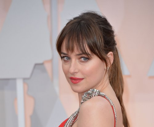 Dakota Johnson hosts 'SNL' with parents Melanie Griffith and Don Johnson in the audience