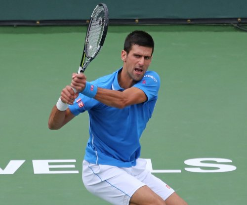 Djokovic beats Federer to win fourth Italian Open