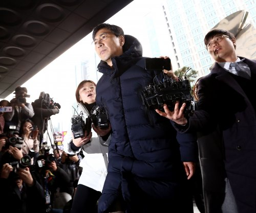 South Korean prosecutors seek warrant to arrest ex-governor