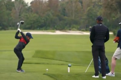 Watch: Tiger Woods, son Charlie show off mirrored golf swings