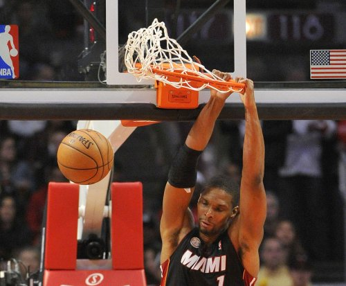 Chris Bosh wants to play but Miami Heat restates he's still out