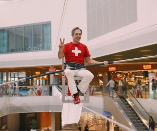 Stuntman balances chair on tightrope for 8-1/2 hours