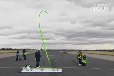 Golfer Marcus Armitage hits ball into moving car to break Guinness record