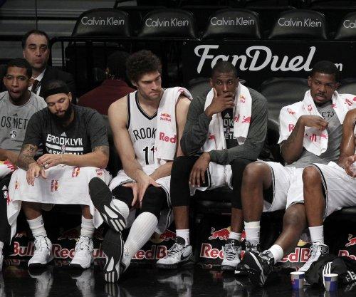 Brooklyn Nets outlast Milwaukee Bucks in triple OT