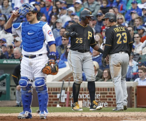 David Freese drives in two as Pittsburgh Pirates hold off Chicago Cubs