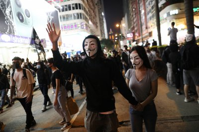 Hong Kong protesters don Guy Fawkes masks to mark month since mask ban