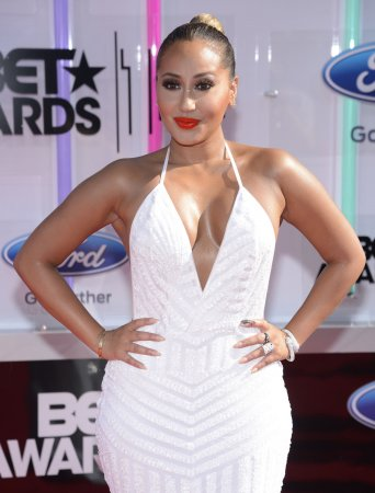 Adrienne Bailon addresses Chris Brown feud